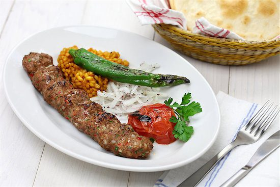 A dish of Kofte served with the delicious spice known as ground sumac.
